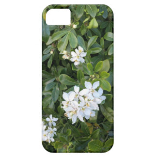 Phone cover with white flowers and green leaves.