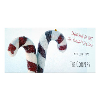 Photo card holiday greetings candy cane on snow