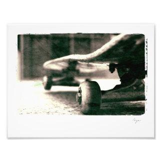 Photo of black and white skateboard