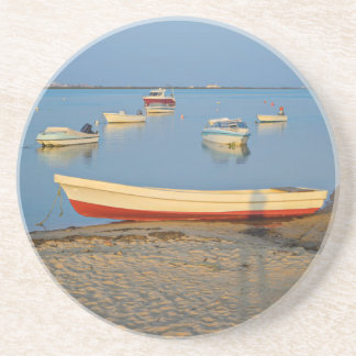 Photo of boats in bay at sunset in Portugal Coaster