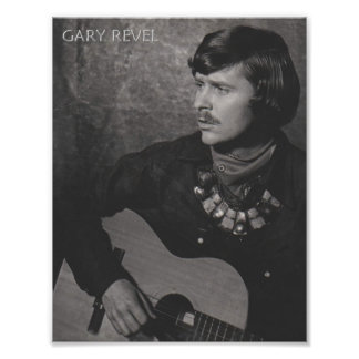 Photo of Gary Revel with guitar, scarf & necklace