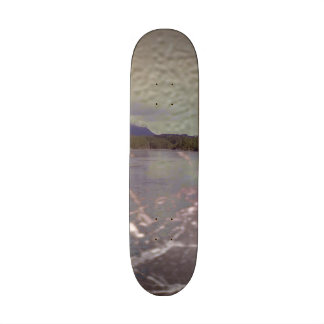 Photo of lake with Texture Skate Board