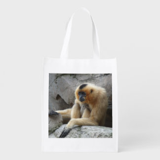 Photo of Orange and Black Gibbon Relaxing on Cliff Reusable Grocery Bags