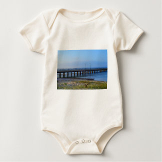 Photo of pier in sunset with anchor baby bodysuit