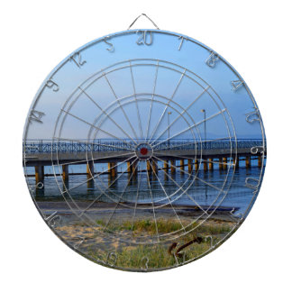 Photo of pier in sunset with anchor dartboard