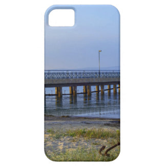 Photo of pier in sunset with anchor iPhone 5 cover