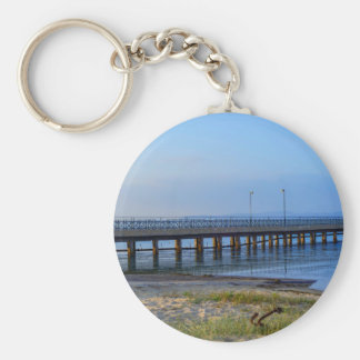 Photo of pier in sunset with anchor keychain