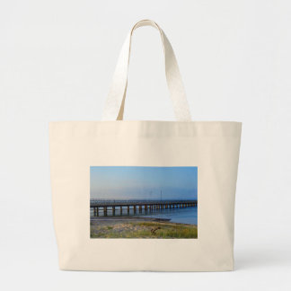 Photo of pier in sunset with anchor large tote bag