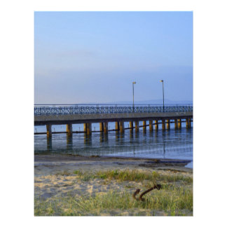 Photo of pier in sunset with anchor letterhead