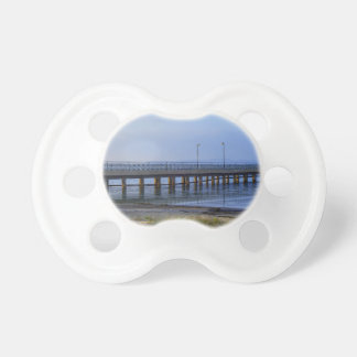 Photo of pier in sunset with anchor pacifier