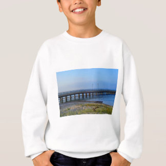 Photo of pier in sunset with anchor sweatshirt
