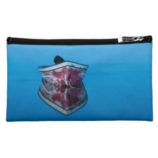 photo small pocket of a boat on water makeup bag