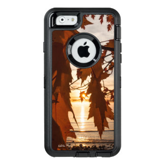 Photograph of maple red sheets OtterBox defender iPhone case