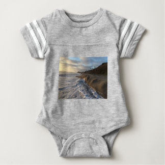 Photograph of the waves hitting the sand baby bodysuit
