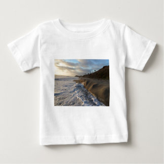 Photograph of the waves hitting the sand baby T-Shirt
