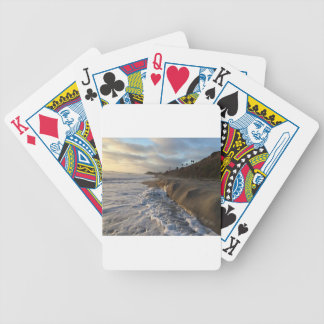 Photograph of the waves hitting the sand bicycle playing cards