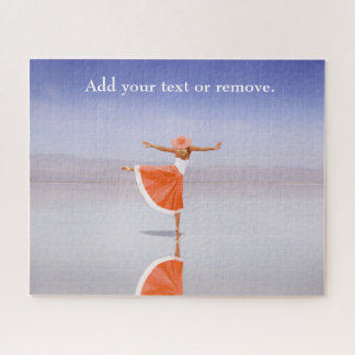 Photograph, woman in orange dancing on the beach. jigsaw puzzle