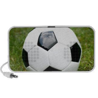 Photographie de ballon de football et d'herbe haut-parleur