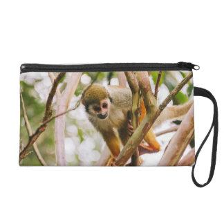 Photographie de singe-écureuil pochette avec dragonne