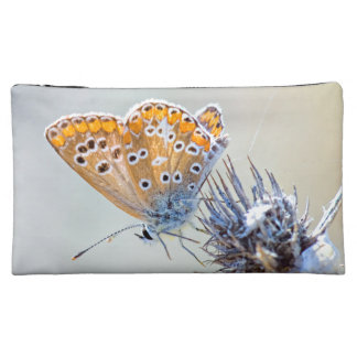 Photography of butterfly in smooth colors cosmetic bags
