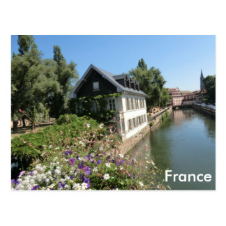 Picturesque house with flowers and canals, France Postcard