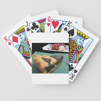 Piece of chocolate cake and cheesecake poker deck