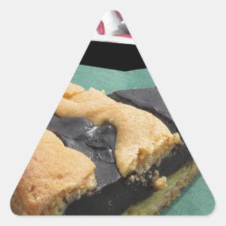 Piece of chocolate cake and cheesecake triangle sticker