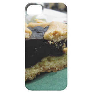 Piece of chocolate cake on green paper napkin case for the iPhone 5