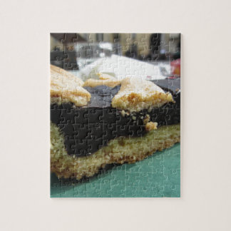 Piece of chocolate cake on green paper napkin jigsaw puzzle