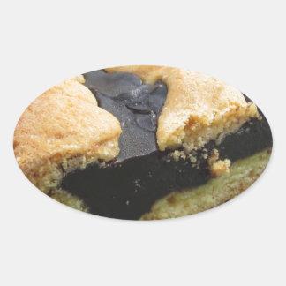 Piece of chocolate cake on green paper napkin oval sticker