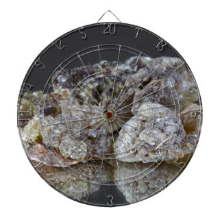 Pieces of natural frankincense resin on a mirror. dartboards
