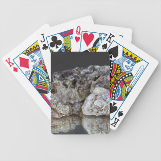 Pieces of natural frankincense resin on a mirror. poker deck