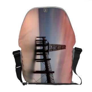 Pier at sunset messenger bag