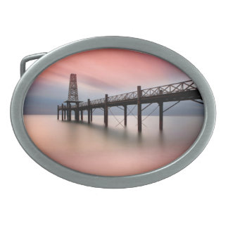 Pier at sunset oval belt buckle