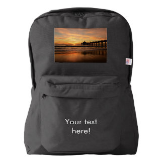 Pier beach sunset backpack