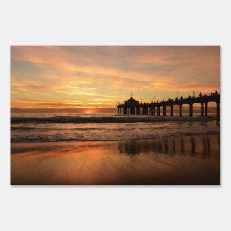 Pier beach sunset sign