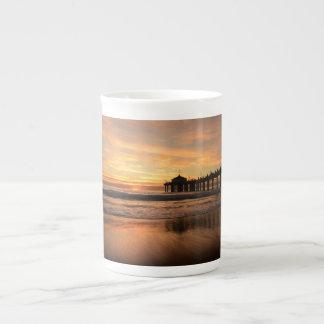 Pier beach sunset tea cup