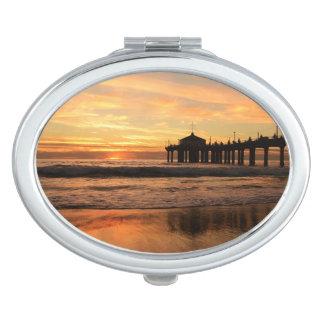 Pier beach sunset travel mirror