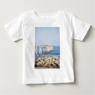 pier with rocks baby T-Shirt