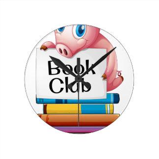 Pig and books round clock