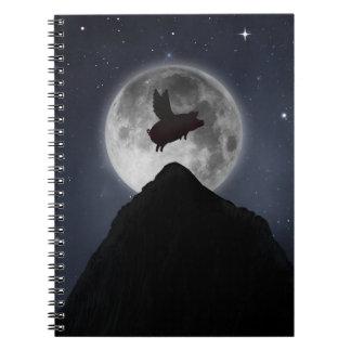 Pig flying over full moon spiral notebooks