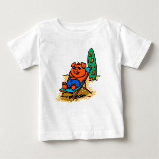Pig sunbathing on the beach baby T-Shirt