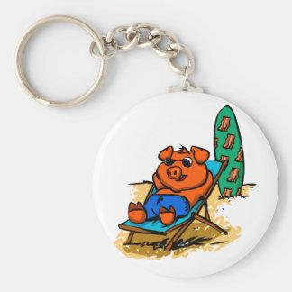 Pig sunbathing on the beach keychain