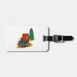 Pig sunbathing on the beach luggage tag