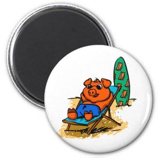 Pig sunbathing on the beach magnet