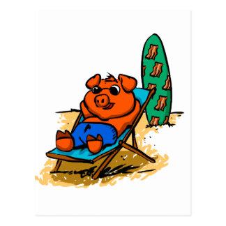 Pig sunbathing on the beach postcard