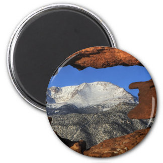 Pikes Peak seen through keyhole rock formation 2 Inch Round Magnet