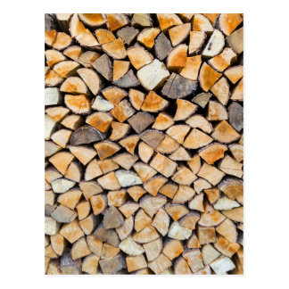 Pile of firewood as tree trunk postcard