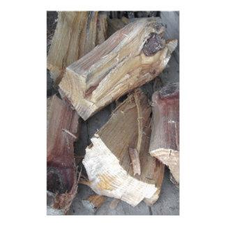 Pile of irregularly chopped firewood on old cart stationery