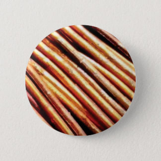 piles of copper pipes 2 inch round button